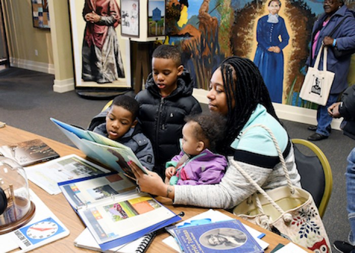 Amy Riley and her husband, Andre, traveled with their sons Aden, 9, and Arie, 4, and daughter Austin, 18 months, during the family's first trip to learn the story of African American history. (Roy Lewis/The Washington Informer)
