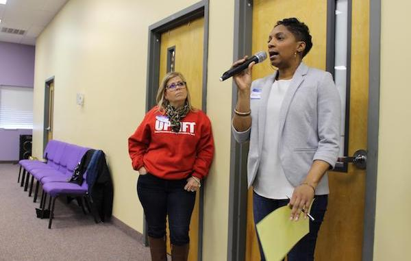 Martha Crawford responds to a facilitator's question at Agape Fellowship's community event, United Prevention through Loving Intervention for Teens (UPLIFT).