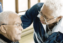 A caregiver assists a victim of Alzheimer's. (Courtesy photo)