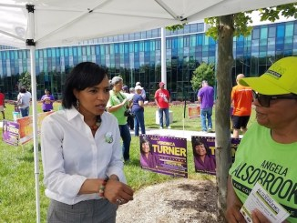 Prince George's County State's Attorney Angela Alsobrooks (left), who is running for county executive, chats with a volunteer outside the Southern Regional Technology and Recreation Complex in Fort Washington, Maryland, on June 14, the first day of early voting in the state. (William J. Ford/The Washington Informer)