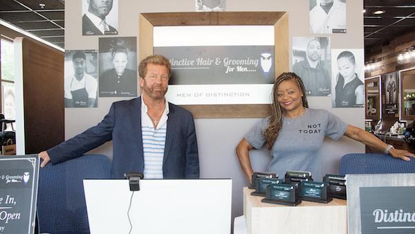 Jim and Deborah Guynn, owners of Distinctive Hair & Grooming for Men (Shevry Lassiter/The Washington Informer)