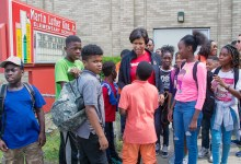 D.C. Mayor Muriel Bowser is surrounded by children from Martin Luther King Jr. Elementary School in the city's Congress Heights neighborhood as she acts as an escort in the Safe Passage program on June 8. Shevry Lassiter/The Washington Informer)
