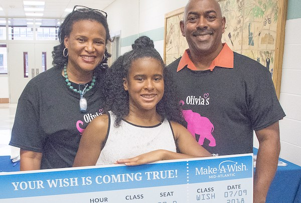 Kevin and Schonay Jones with their daughter Olivia, who received a trip to South Africa from Make-A-Wish Mid-Atlantic during an 8th grade farewell ceremony in Silver Spring, Md., on June 8 (Shevry Lassiter/The Washington Informer)