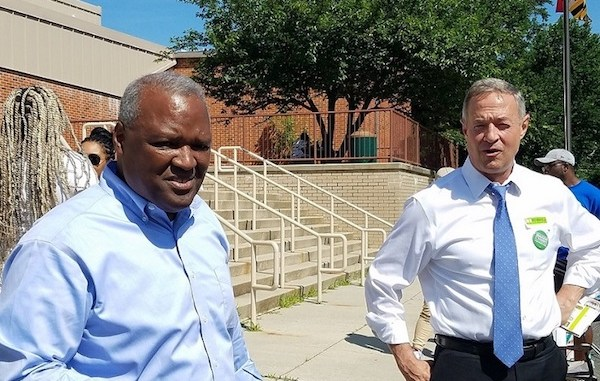 Former Maryland Gov. Martin O'Malley (right) stumps for Prince George's County Executive Rushern L. Baker III, who is running for governor, before he votes June 26 at Gladys Noon Spellman Elementary School in Cheverly in the state's primary election. (William J. Ford/The Washington Informer)