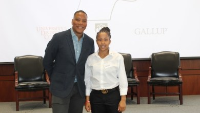 "Samiya Hatcher, a recent McKinley Tech High School graduate, poses with WUSA-TV's Reese Waters, who was the emcee for the Capital Builders Center's ""Signing Day"" event in the Great Room in the Gallup Building in D.C. on June 15. (Brigette White/The Washington Informer)"