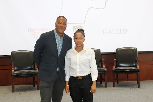 """Samiya Hatcher, a recent McKinley Tech High School graduate, poses with WUSA-TV's Reese Waters, who was the emcee for the Capital Builders Center's """"Signing Day"""" event in the Great Room in the Gallup Building in D.C. on June 15. (Brigette White/The Washington Informer)"""