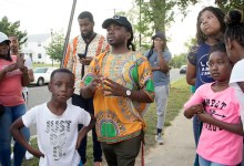 Ward 8 Council member Trayon White stands with local residents at a June 1 prayer vigil, where several homicides have taken place near Ferebee Hope Elementary School in southeast D.C. (Shevry Lassiter/The Washington Informer)