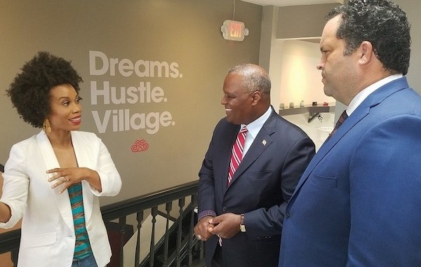 Eunique Jones-Gibson (left) talks about Dream Village, a shared-workspace business in Hyattsville she opened in February, to Prince George's County Executive Rushern L. Baker III and Maryland Democratic gubernatorial nominee Ben Jealous, who toured the outfit on July 18. (William J. Ford/The Washington Informer)