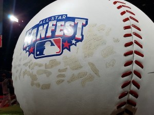 The world's largest baseball, which stands 12½ feet in diameter with signatures from Hall of Famers such as Hank Aaron, Willie Mays and Bert Blyleven, is on display at the Washington Convention Center in D.C. for the GEICO All-Star FanFest. (William J. Ford/The Washington Informer)