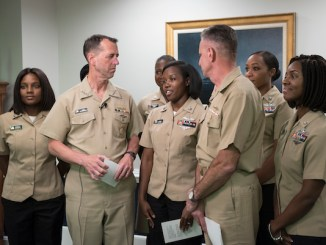 Navy officials have authorized ponytails and other styles for female sailors in working and service uniforms. (Courtesy of the U.S. Navy)