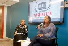 "Isisara Bey (left), artistic director of the March on Washington Film Festival, interviews hairstylist Camille Friend, who worked on the set of ""Black Panther,"" at the festival's ""Breakfast with a Friend"" event in the offices of the Raben Group in D.C. on July 13. (Brenda C. Siler/The Washington Informer)"