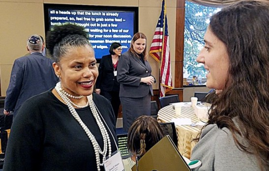 Donna Walton (left), who moderated a panel on intersectionality at a July 30 conference on Capitol Hill hosted by RespectAbility, chats with Leah Nodvin, a legislative aide for Rep. Brad Sherman (D-California). (William J. Ford/The Washington Informer)