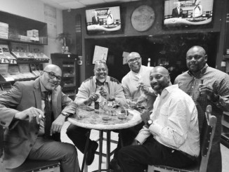 Partners Greg Hurt, Darryl Redmond (friend), Greg Willis, Darnell Streat and Maurice Holland worked together to create a quality cigar line. (Not pictured: Robert Howard) (Courtesy of Urban News Service)