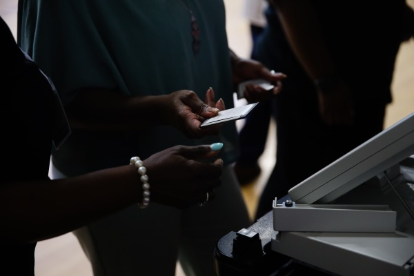 Election officials collect electronic voting machine memory cards following the Georgia primary runoff elections at a polling location in Atlanta on Tuesday, July 24, 2018. (Elijah Nouvelage/Bloomberg via Getty Images)