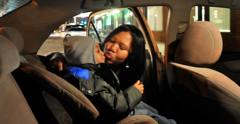 Tyreik Reese, one of the children in Happy Faces Learning Center evening program, getting a kiss from his mother, Tarnika Hall after being put in the car seat on March 01, 2012 in Washington, DC. (Photo by Mark Gail/The Washington Post via Getty Images)