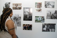 A visitor looks at the Anacostia Unmapped 2.0 exhibit on display at the DC Commission on the Arts and Humanities building in Southeast. (Shevry Lassiter/The Washington Informer)
