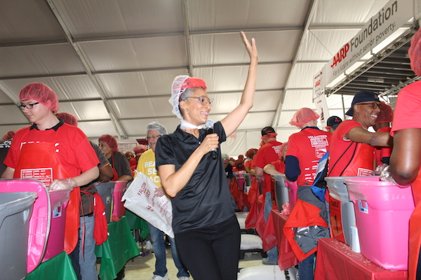 Chef Carla Hall, AARP spokesperson, encourages the over 6,000 volunteers who came to the National Mall on September 11 for a day of service as they packed meals for the senior community. (Brigette Squire/The Washington Informer)