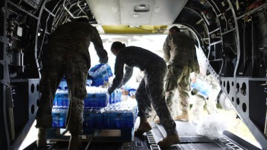 U.S Army soldiers offload bottled water from a helicopter during recovery efforts four weeks after Hurricane Maria struck on October 18, 2017, in Utuado, Puerto Rico. U.S. soldiers and agents delivered food and water provided by FEMA to remote residents in mountainous Utuado. Puerto Rico is suffering shortages of food and water in areas with only 19.10 percent of grid electricity restored. Puerto Rico experienced widespread damage including most of the electrical, gas and water grid as well as agriculture after Hurricane Maria, a category 4 hurricane, swept through. (Photo by Mario Tama/Getty Images)