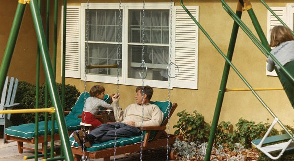 President John F. Kennedy relaxes with his children, John Jr. and Caroline, on the patio of Wexford, his Middleburg retreat on November 10, 1963. Nancy and Ronald Reagan (who also loved to take long rides in the horse country around Middleburg) later rented the same house from subsequent owners in 1980, prior to his taking office.  (Photo by Cecil Soughton, The White House/Kennedy Library).
