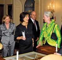 Curator Marcee Craighill (center) greets her predecessor, Gail Serfaty, at a recent Diplomatic Reception Rooms dinner.