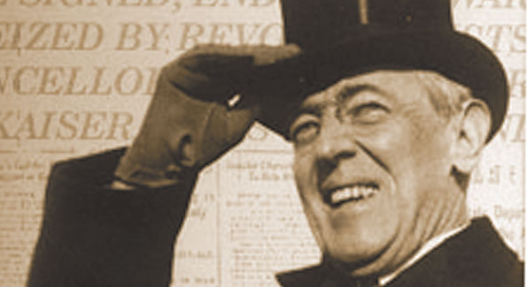 President wilson smiling as WWI comes to an end.