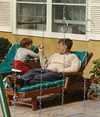 President John F. Kennedy relaxes with  John Jr. on the patio of Wexford, his Middleburg retreat on November 10, 1963. (Photo by Cecil Soughton, The White House)