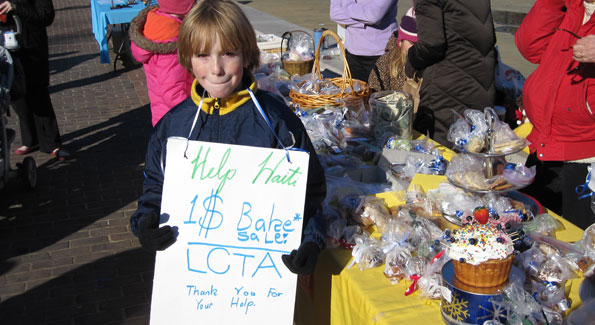 Ben, a student at Lyles-Crouch Traditional Academy, helped raise over $1,500 for Haiti in Old Town Alexandria's Farmers' Market. (Photo by Jane Hess Collins)