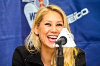 Anna Kournikova serves a beautiful smile for WTT Smash Hits.