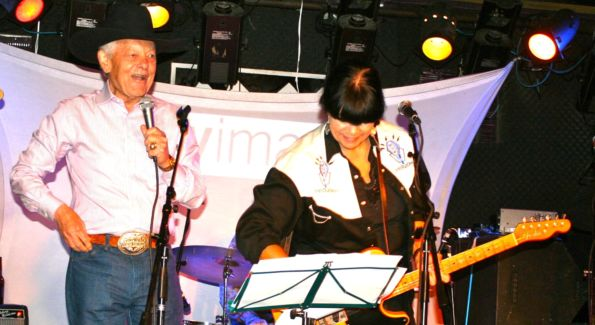 Bob Schieffer takes the stage with Honky Tonk Confidential band member Diana Quinn at the Mr. Holland's Opus Foundation benefit. (Photo by Janet Donovan)