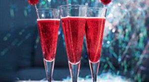 The Poinsettia cocktail is festively-hued and can be partially mixed in advance.