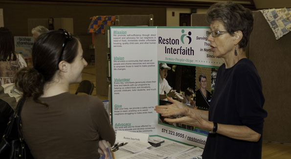 Shaunel Brown talks with a representative from Reston Interfaith during the 2010 Service Expo. Photo by Landon Densley.