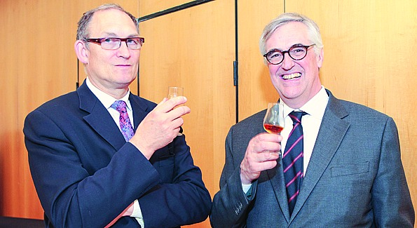 A toast with Maurice Hennessy (right) at the French Embassy. Photo by Alfredo Flores.