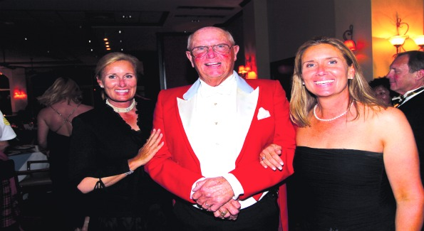 Emily Smith, Scott Traphagen and Patricia Luke at the Palm Beach Hounds Hunt Ball at the Albacoa Golf Club.