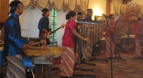 A traditional Indonesian band plays for guests as they enjoy Indonesian cuisine and the majestic estate.
