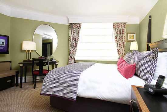 One of St. Ermin's many well-appointed rooms with a king-sized bed. (Courtesy photo)