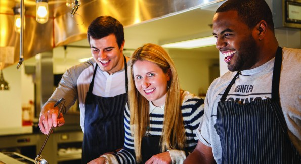 Ryan Kerrigan, Laura Wainman and Darrel Young mix it up in the Redskins' kitchen. (Photo by Jay Snap)