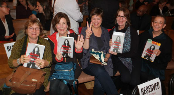 "Guests hold Gloria Steinem's book ""My Life on the Road"" (Photo by Bruce Guthrie)"