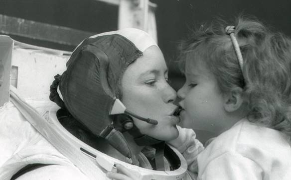 Kristin kissing her mother Anna Lee Fisher
