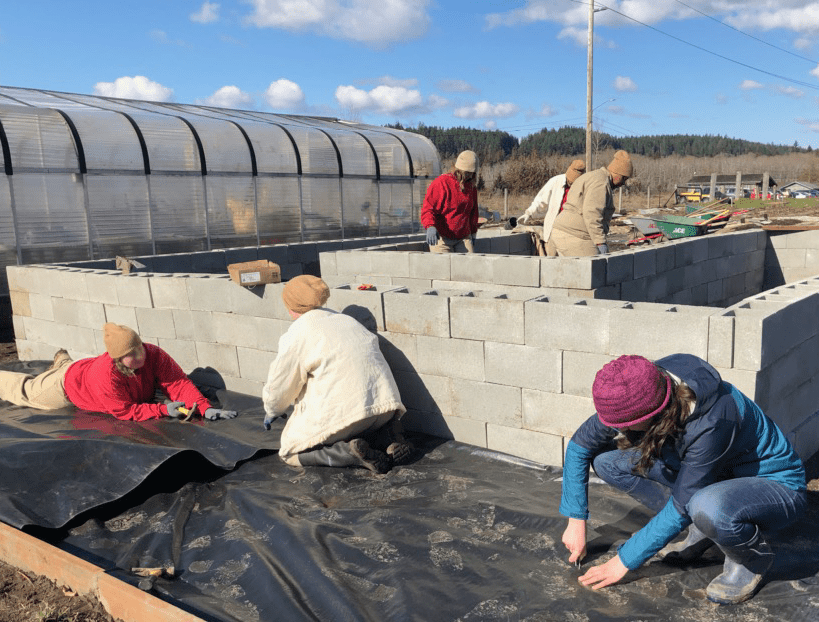 WSC AmeriCorps member Heather and community volunteers serving at Hood Canal Salmon Enhancement group in Belfair, WA