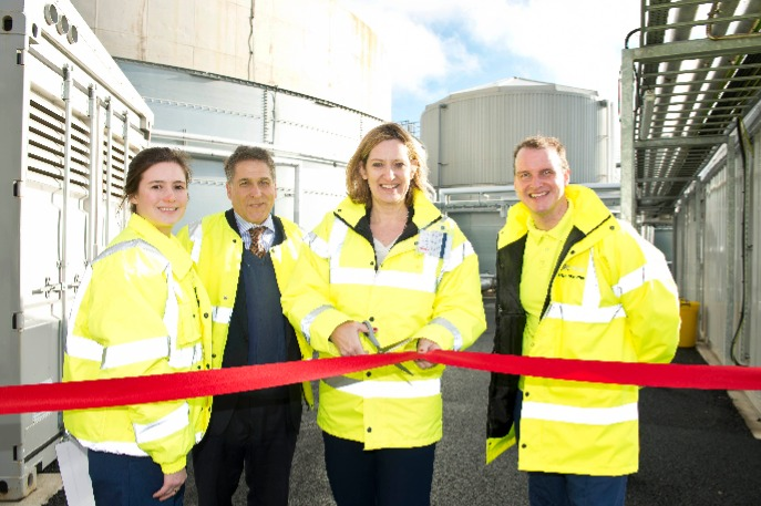 Image shows Amber Rudd MP cutting the tape tp open a new anaerobic digestion plant