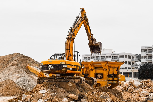 Construction waste recycling in action on a site assisted by a UK Site Waste Management Plan Template.
