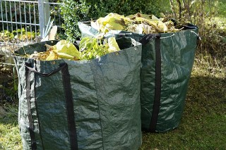 Image shows Garden Waste bagged and ready for collection.