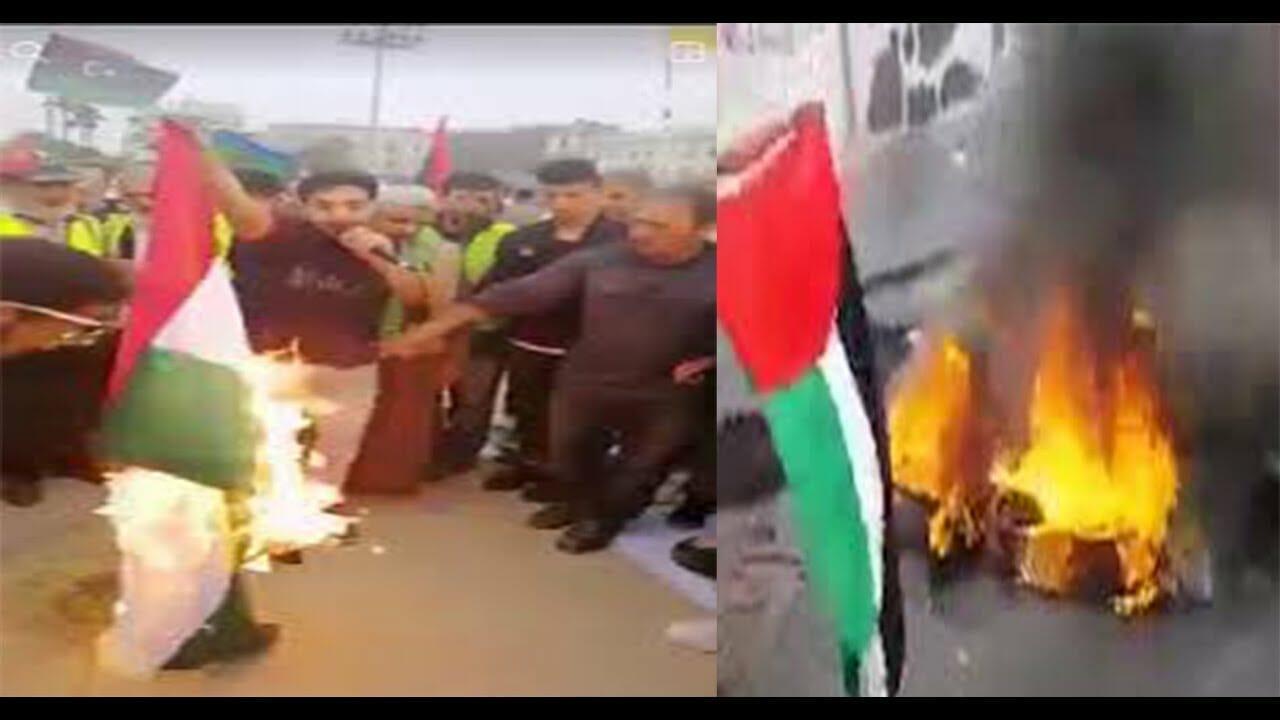حرق علم الامارات في طرابلس