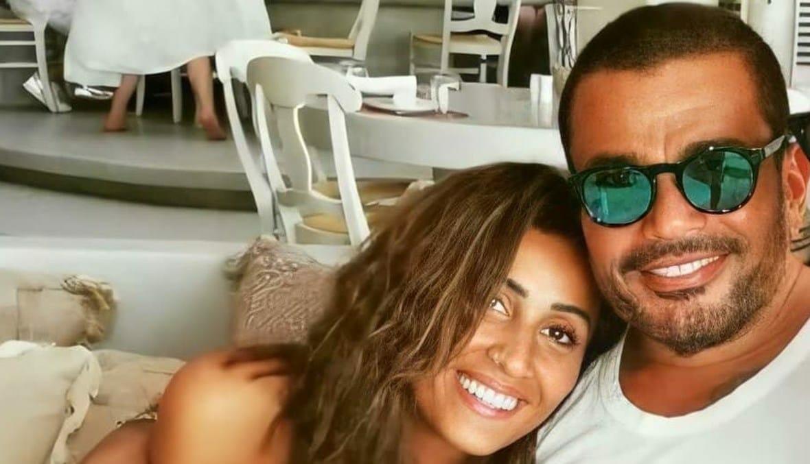 عمرو دياب أثار حالة من الجدل والشك حول عودته إلى دينا الشربيني خلال حفله الأخير بالساحل