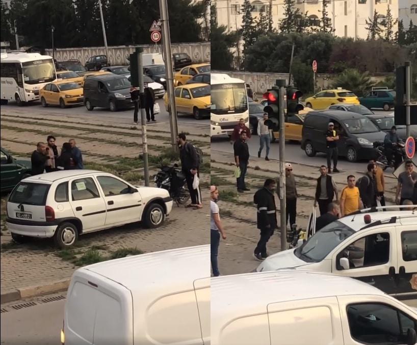 رجل أمن تونسي يشهر مسدّسه في وجه مواطن