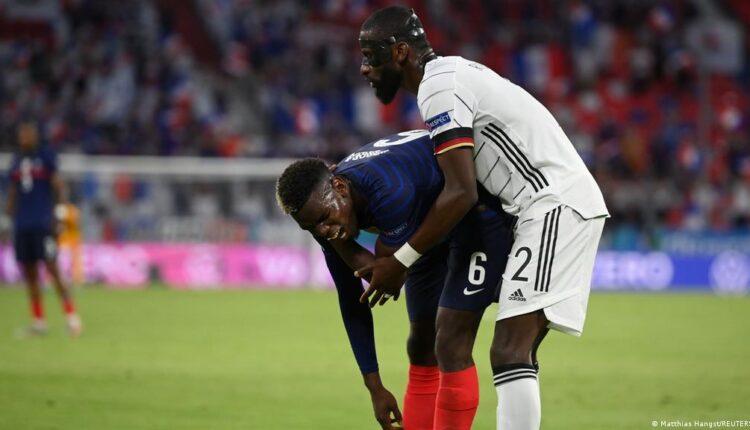 روديجر يحاول عض النجم الفرنسي بول بوغبا
