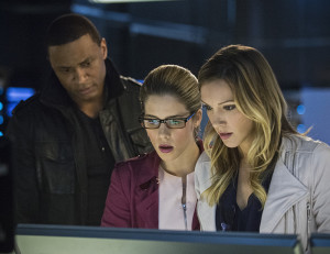 "Arrow -- ""Al Sah-Him"" -- Image AR321B_0222b-- Pictured (L-R): David Ramsey as John Diggle, Emily Bett Rickards as Felicity Smoak and Katie Cassidy as Laurel Lance -- Photo: Cate Cameron/The CW -- © 2015 The CW Network, LLC. All Rights Reserved."