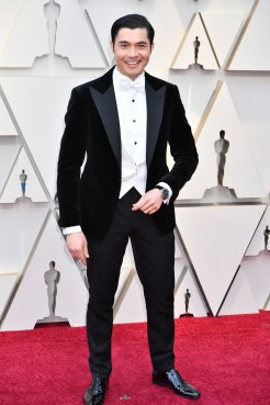 Henry Golding wearing IWC at the 91st Annual Academy Awards
