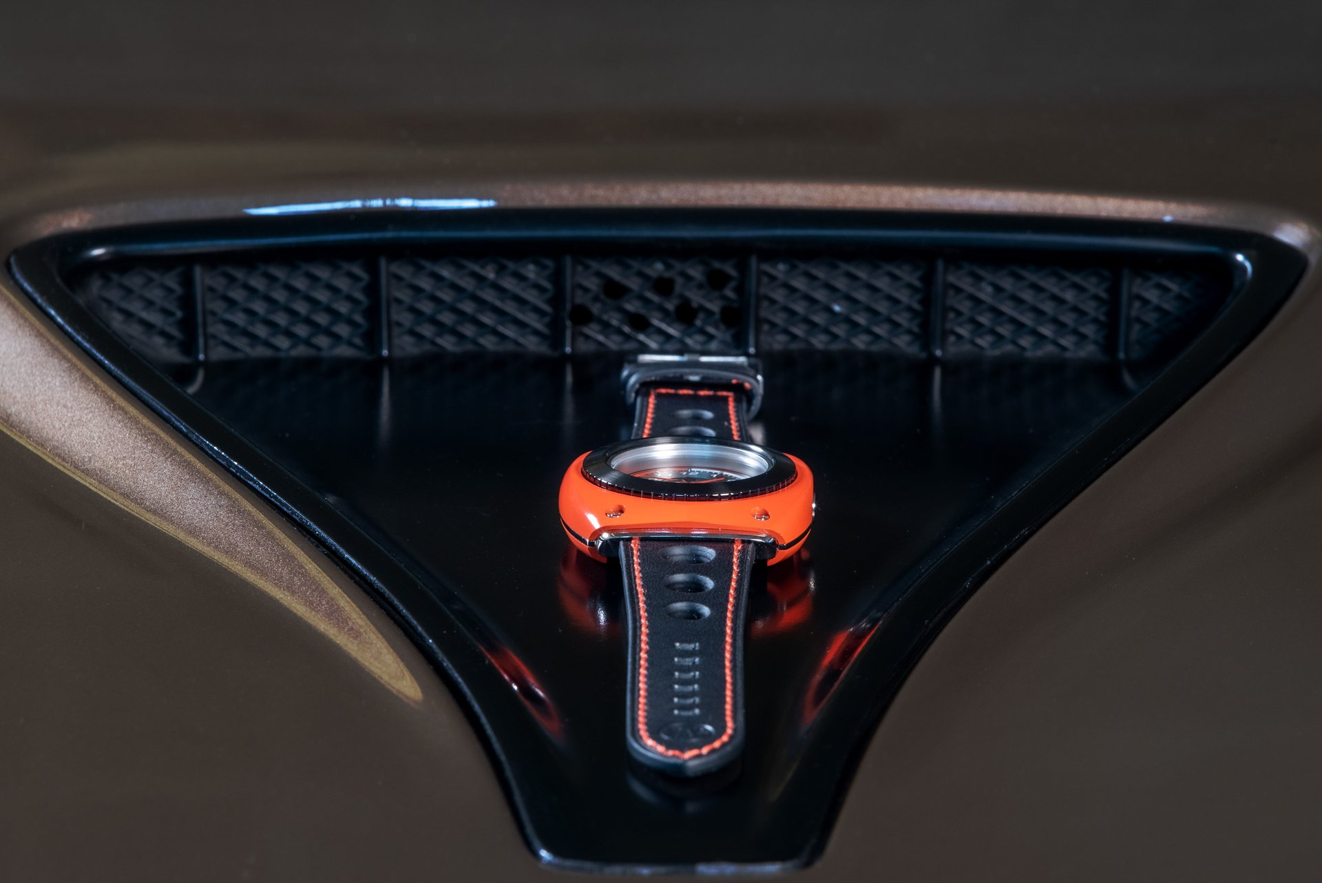 Blasta Watch Scuderia Veloce, rosso scuderia. Photo taken on the hood of a Alfa Romeo Montreal. ©2019 Blasta Watch Ltd. All Rights reserved.