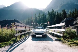 "AROSA, SWITZERLAND – 01. September 2019: The IWC Racing Team showed up on the grid of the 15th Arosa Classic Car for the second time. Bernd Schneider drove the Mercedes-Benz 300 SL ""Gullwing"" on the winding 7.3 kilometre hill-climb route from Langwies to Arosa. (Photo by Ted Gushue for IWC)"
